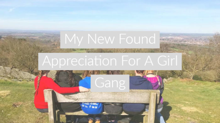"Girls sat on a bench with their backs to the camera at the top of a large hill with text overlay ""My New Found Appreciation For A Girl Gang"""
