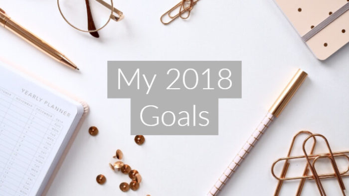 "flatlay image f pink and rose gold statioary, notebpads and pens with text overlay ""my 2018 goals"""
