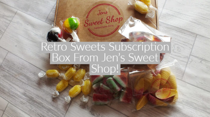 "flaylay style iage of various retro boiled sweets and lollipops spilliong out of a brown cardboard box, with text overlay ""Retro Sweets Subscription Box From Jen's Sweet Shop!"""