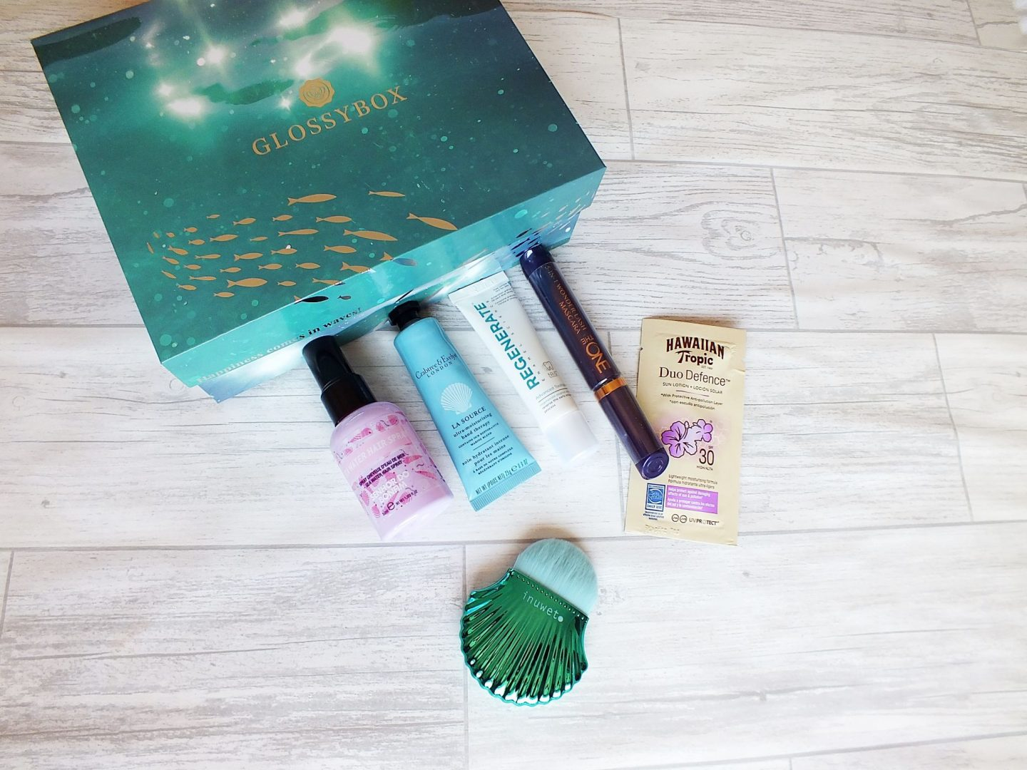 July Glossybox with products lined up on it