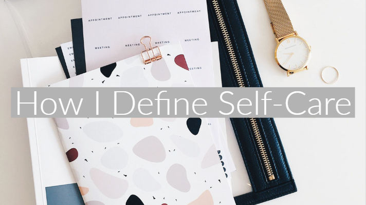 Graphic on stationary flatlay background with text 'how I define self-care'