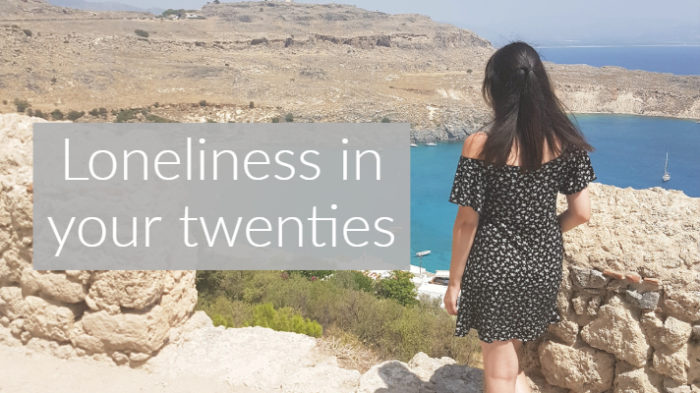 girl overlooking ocean from clifftop with text saying loneliness in your twenties