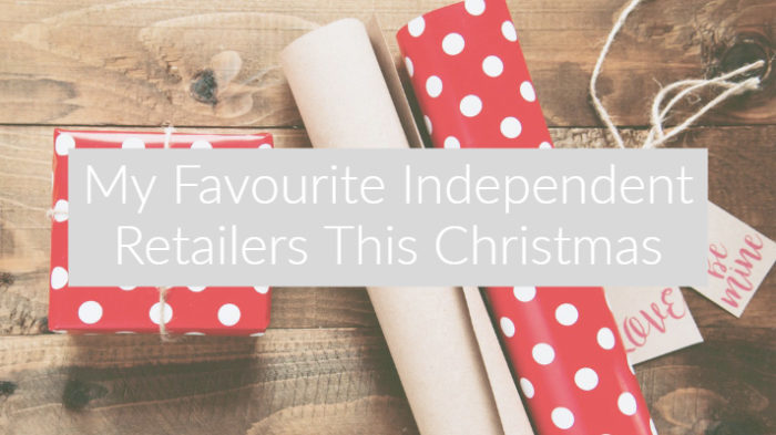 "Red and white spotty christmas wrapping paper and present on dark wood floor with text overlay ""My Favourite Independent Retailers This Christmas"""