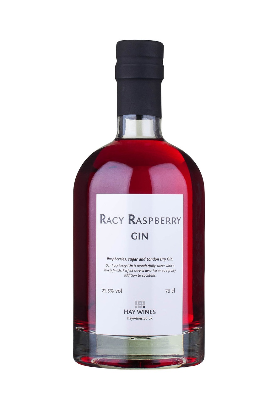 Bottle of red Racy Raspberry gin on white background with white label on bottle