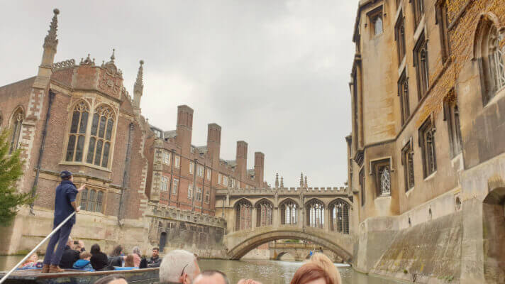 traditional english buildings viewed from the river in cambridge