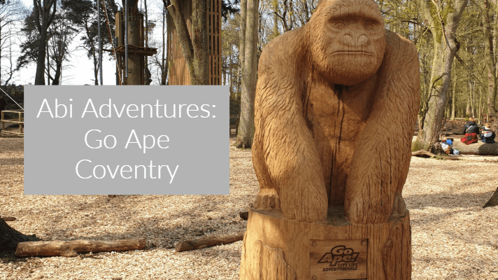 wooden ape statue in a forest setting