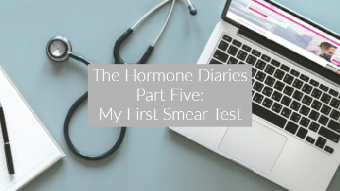 Photo taken from above showing ope laptop with pink and white website open, with a stethescope to the left. Text overlay says The Hormone Diaries Part 5: My First Smear Test
