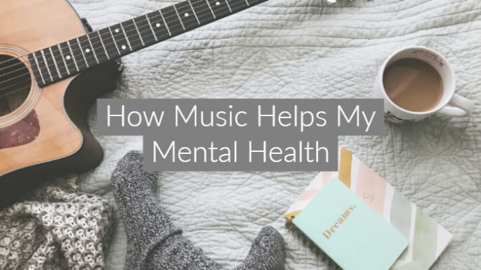"""Flatlay style image of a guitar, mug of tea, notepads and grey socks witb text overlay """"how music helps my mental health"""""""